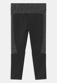 Puma - EVOSTRIPE UNISEX - Teplákové kalhoty - puma black - 1