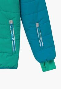 TrollKids - HAFJELL SNOW PRO UNISEX - Lyžařská bunda - light petrol / dark mint / white - 3