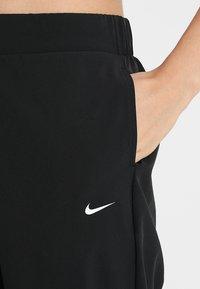 Nike Performance - Pantalon de survêtement - black/white - 4