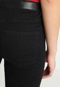 Vero Moda - VMJULIA FLEX IT MR SLIM JEGGING GU1 - Jeans Skinny Fit - black - 4