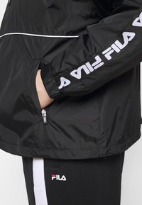 Fila Plus - TATTUM WIND JACKET - Kevyt takki - black/bright white - 6