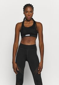 Puma - PAMELA  REIF X PUMA  COLLECTION LAYER SPORT CROP  - Medium support sports bra - black - 0