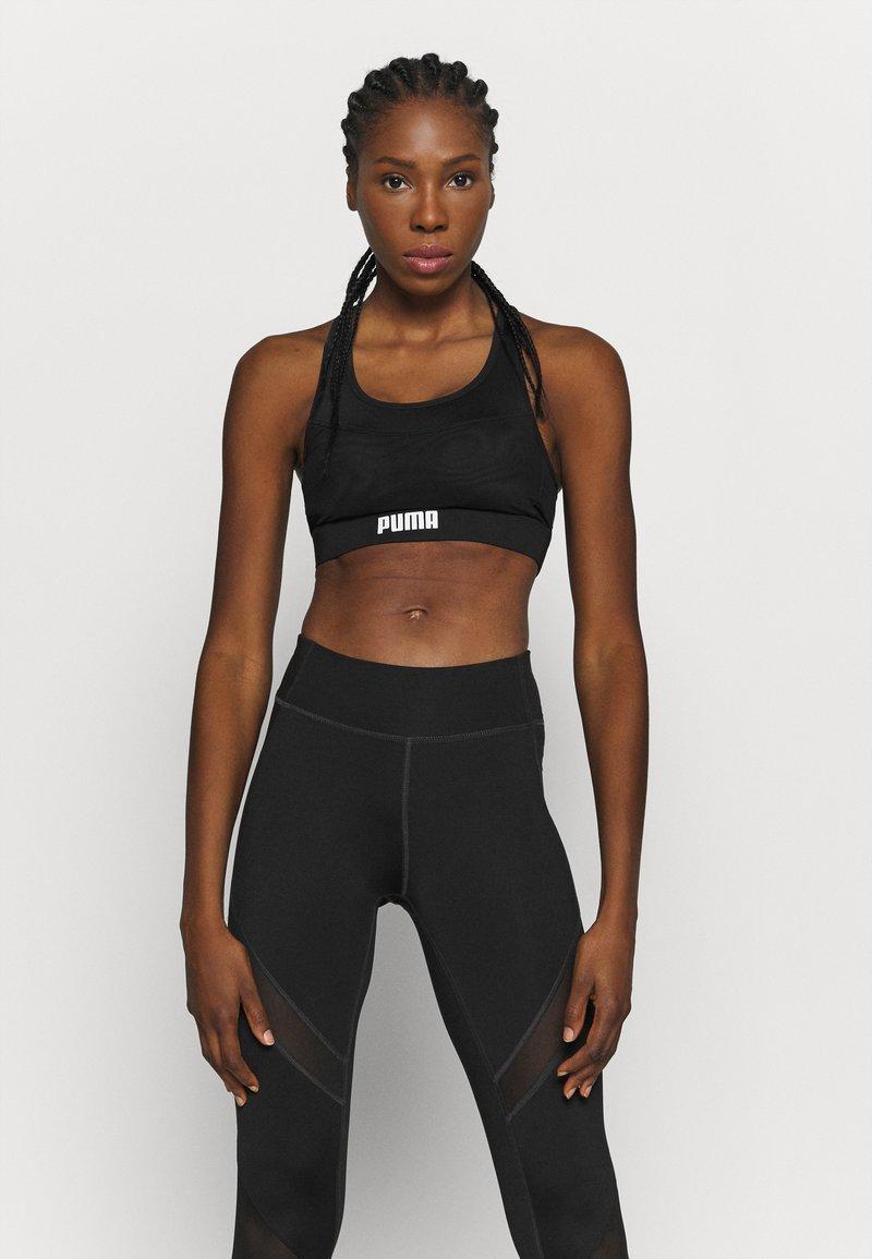 Puma - PAMELA  REIF X PUMA  COLLECTION LAYER SPORT CROP  - Medium support sports bra - black