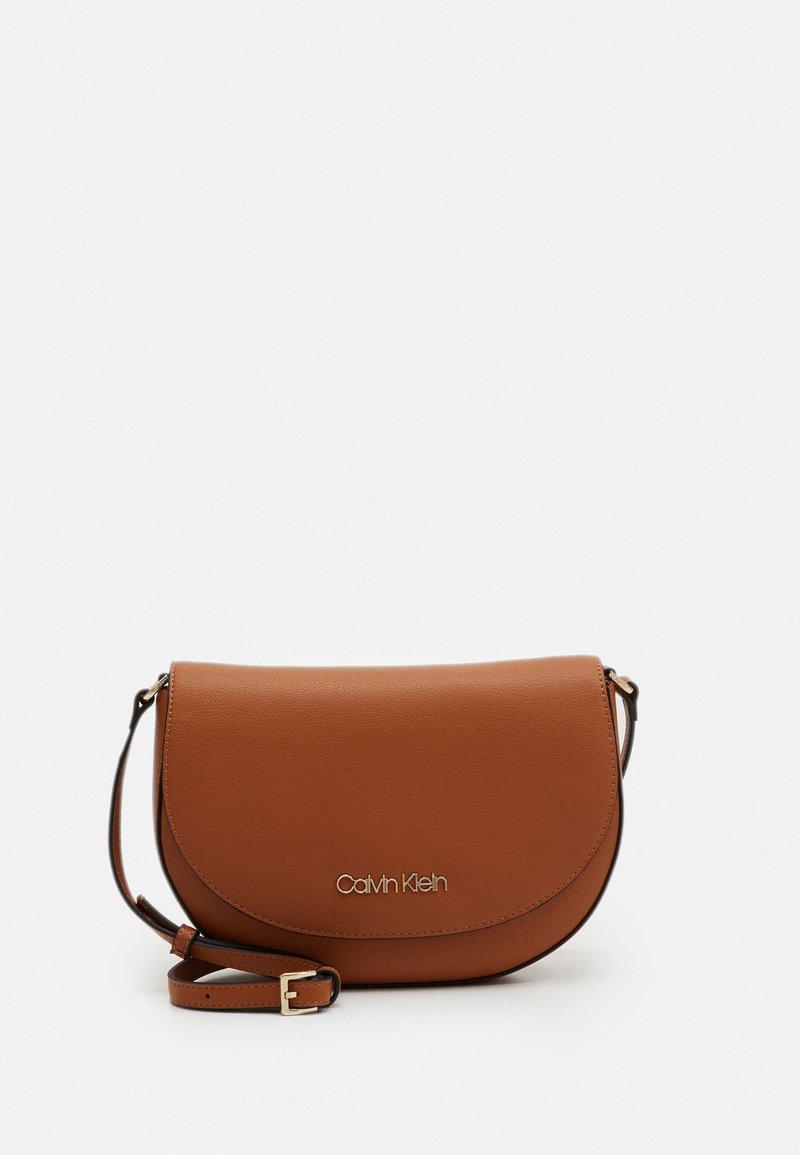 Calvin Klein - SADDLE BAG - Across body bag - brown