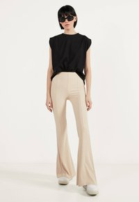 Bershka - Trousers - white - 1