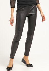 MICHAEL Michael Kors - Leather trousers - black - 0