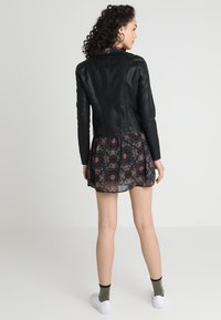 Vero Moda - VMRIA SHORT JACKET - Faux leather jacket - black - 2