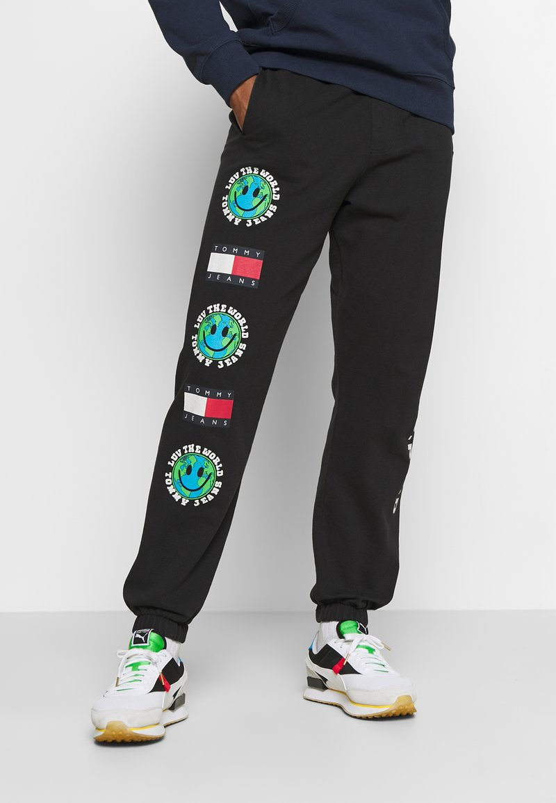 Tommy Jeans - LUV THE WORLD UNISEX - Tracksuit bottoms - black