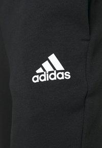 adidas Performance - DK ESSENTIALS - Tracksuit bottoms - black/white - 4