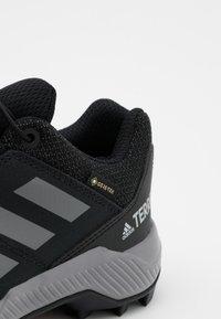 adidas Performance - TERREX GTX UNISEX - Hiking shoes - core black/grey three - 5