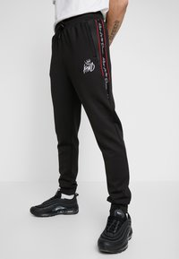 Kings Will Dream - DEFLOUR JOGGERS WITH TAPING - Tracksuit bottoms - black - 3