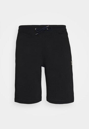 REGULAR FIT - Tracksuit bottoms - black