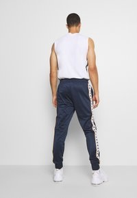 Kappa - HELGE PANT - Tracksuit bottoms - total eclipse - 2