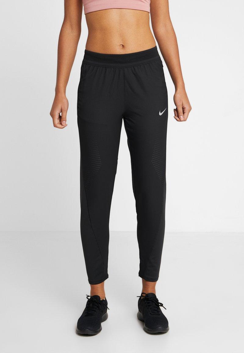 Nike Performance - Tracksuit bottoms - black/reflective silver