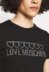 Love Moschino - Print T-shirt - black - 4