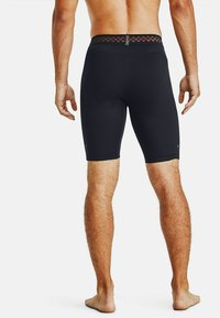 Under Armour - 3/4 sports trousers - black - 0