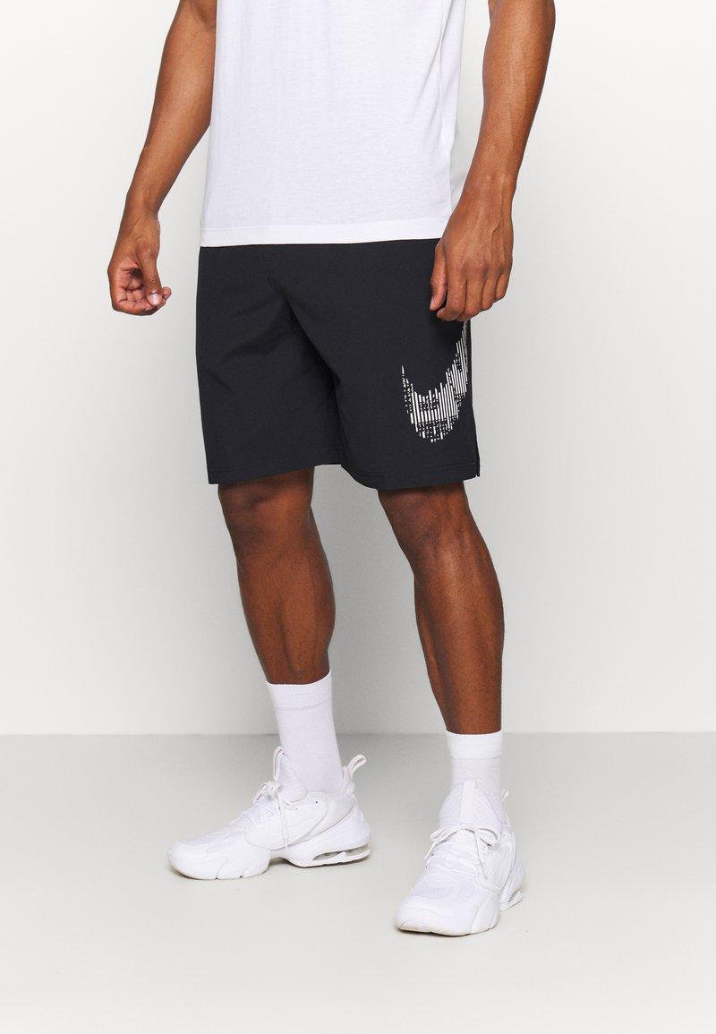 Nike Performance - M FLX GFX - Sports shorts - black