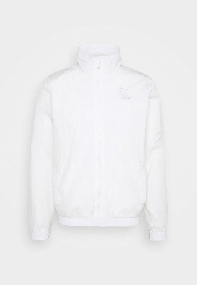 UNISEX SIGNATURE TRACKJACKET - Training jacket - off white