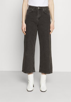 CINZIA - Flared Jeans - black
