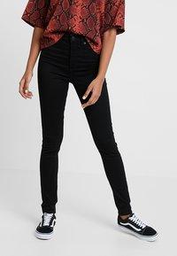 Monki - OKI - Slim fit jeans - black deluxe - 0
