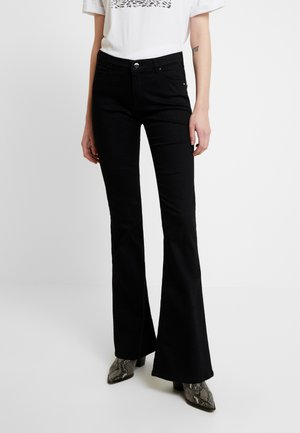 STELLA - Flared Jeans - black