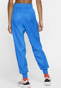 Nike Sportswear - Tracksuit bottoms - pacific blue/white - 1