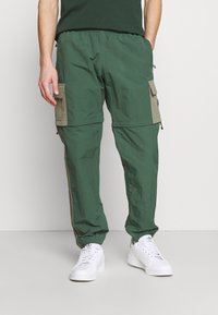 adidas Originals - UTILITY TWO IN ONE ORIGINALS - Cargo trousers - green oxide/clay - 3