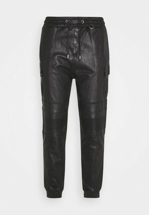 RADY - Leather trousers - black