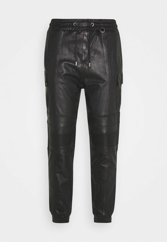RADY - Leather trousers - black