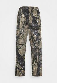 Sweet SKTBS - SWEET LOOSE SURFER PANTS UNISEX - Trousers - green - 1
