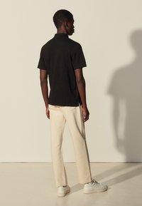sandro - TEDDY - Polo shirt - noir - 2