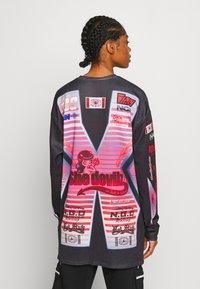 NEW girl ORDER - SHE DEVIL MOTORCROSS LONG SLEEVE - Bluzka z długim rękawem - black - 2