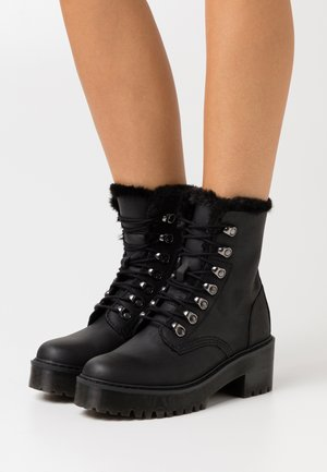 LEONA - Platform ankle boots - black