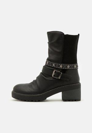 DORIS - Platform ankle boots - black