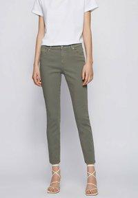 BOSS - Slim fit jeans - dark green - 0