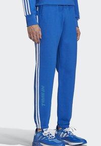 adidas Originals - NINJA PANT UNISEX - Tracksuit bottoms - blue - 3