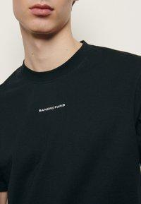 sandro - SOLID TEE UNISEX - Basic T-shirt - noir - 4