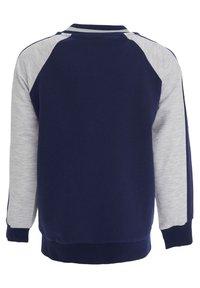 DeFacto - Zip-up sweatshirt - navy - 1