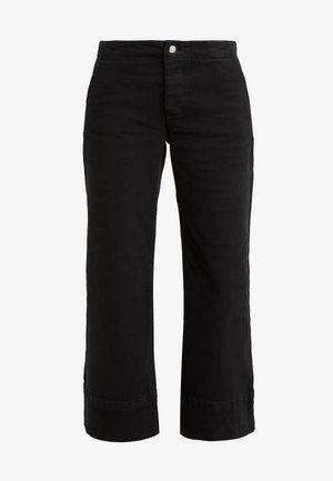 ACTION PANTS - Trousers - black
