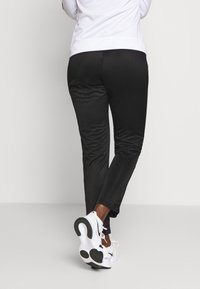 Champion - FULL ZIP SUIT LEGACY - Tracksuit bottoms - white - 4