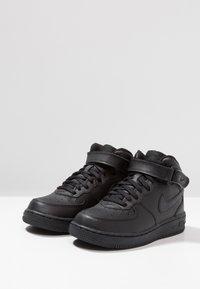 Nike Sportswear - AIR FORCE 1 MID - High-top trainers - black - 3