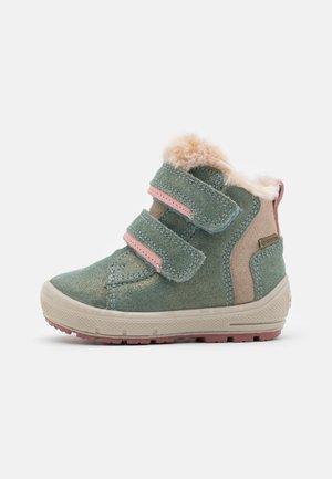 GROOVY - Winter boots - hellgrün/beige