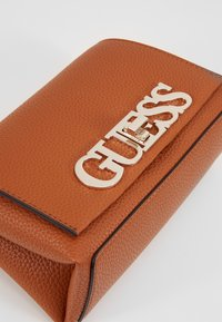 Guess - UPTOWN CHIC MINI XBODY FLAP - Borsa a tracolla - cognac - 2