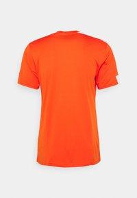 adidas Performance - SQUAD 21 - T-shirt z nadrukiem - teaora/white - 7