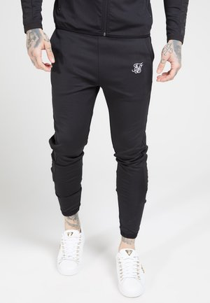 CREASED PANTS - Pantalones deportivos - black