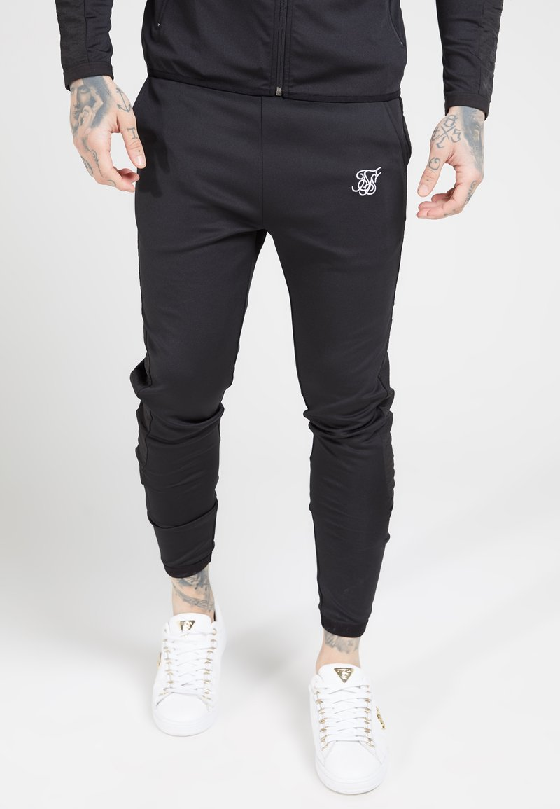 SIKSILK - CREASED PANTS - Verryttelyhousut - black