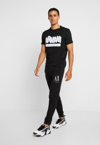 Armani Exchange - JOGGER - Jogginghose - black - 1