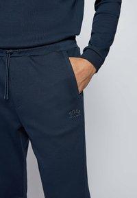 BOSS - HADIM - Tracksuit bottoms - dark blue - 3