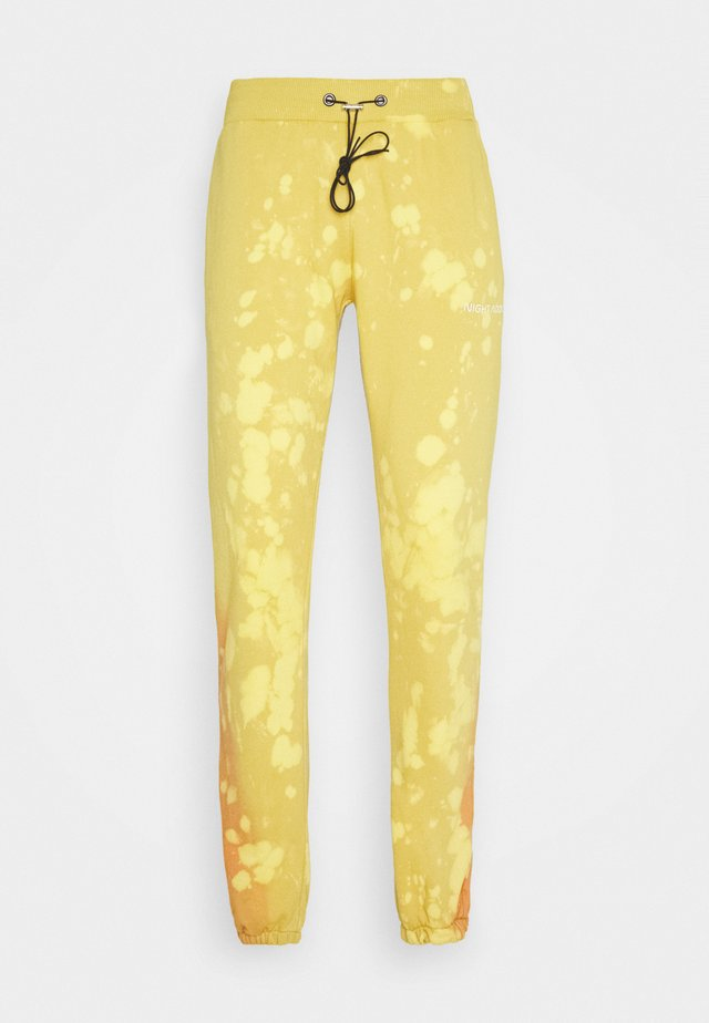 UNISEX - Tracksuit bottoms - yellow