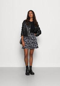 Calvin Klein Jeans - LOGO WAISTBANDSKIRT - Mini skirt - black floral aop - 1